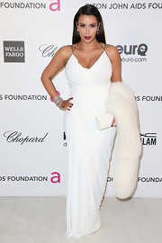 Kim Kardashian accessorized with a white fur stole for added glamour to her gown.