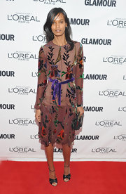 Liya Kebede was ultra feminine in a floral frock. She topped off her look with strappy peep-toe sandals.
