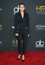 Elizabeth Olsen was sleek and stylish in a black pantsuit by Dolce & Gabbana at the Hollywood Film Awards.