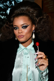 Andra Day topped off her flamboyant look with an exaggerated cat eye.