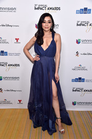 Aimee Garcia styled her dress with elegant silver sandals.