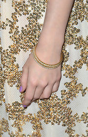 Emmy Rossum kept her jewelry simple and elegant at 'A Night at Sardi's' when she sported two diamond bangles.