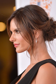 Alessandra Ambrosio oozed sex appeal wearing this loose updo at the Race to Erase MS event.