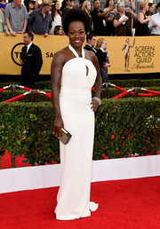 Viola Davis channeled '70s-era glamour in a white Max Mara keyhole-neckline halter gown teamed with a funky afro at the SAG Awards.