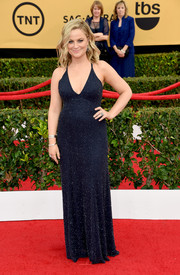 Amy Poehler looked a little more daring than usual in a micro-beaded, deep-V navy gown by Jenny Packham at the SAG Awards.