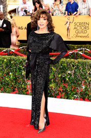 Joan Collins made an appearance at the SAG Awards looking as fierce as ever in a sequined black gown.