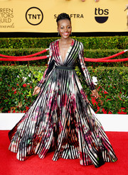 Lupita Nyong'o ruled the SAG Awards red carpet in this stunner of a gown--an Elie Saab masterpiece featuring black stripes on a floral background and just about the most regal silhouette in all of Hollywood!