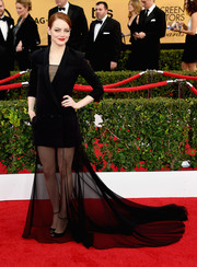 Emma Stone donned a black Christian Dior Couture tuxedo gown that stood out on the SAG Awards red carpet for its uniqueness and glam-drogynous allure.