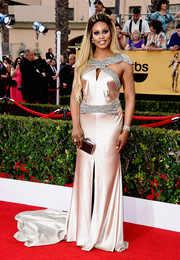 Laverne Cox hit the SAG Awards red carpet looking like a goddess in a pale-blush Johanna Johnson gown featuring a bedazzled waistband and shoulder straps and a long train.