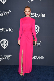 Kate Bosworth styled her dress with gold ankle-strap sandals by Jimmy Choo.