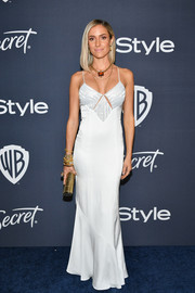 Kristin Cavallari styled her look with a gold tube clutch.