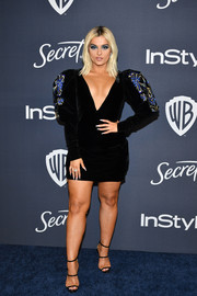 Bebe Rexha hit the Warner Bros. and InStyle Golden Globes after-party wearing a Yanina Couture LBD with embroidered, puffed sleeves.