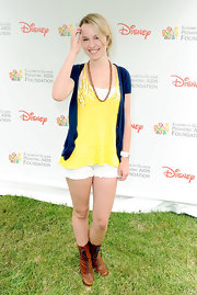 Brown lace-up boots added some toughness to Bridgit Mendler's girly getup.