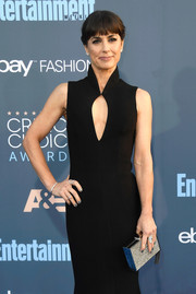 Constance Zimmer paired a silver Monique Lhuillier box clutch with a keyhole-cutout dress for the Critics' Choice Awards.