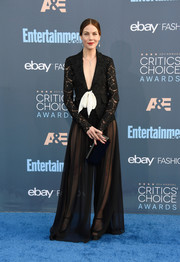 A simple faceted clutch by Tyler Ellis rounded out Michelle Monaghan's all-black look.