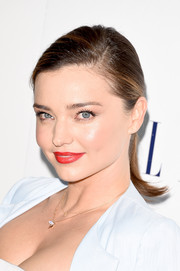 Miranda Kerr perked up her beauty look with a bright red lip.