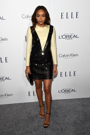 Ashley Madekwe went for a rocker-meets-retro vibe with this studded two-tone leather dress by Calvin Klein at the Elle Women in Hollywood Awards.