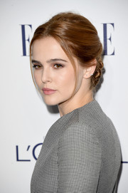 Zoey Deutch attended the Elle Women in Hollywood Awards rocking a twisty updo.