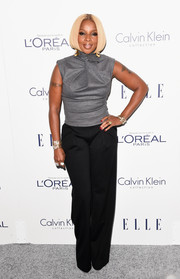 Mary J. Blige donned a fitted, high-neck gray top for the Elle Women in Hollywood Awards.