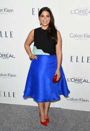 A red satin clutch and matching pumps provided a striking contrast to America Ferrera's blue skirt.