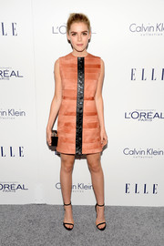 Kiernan Shipka looked fabulously mod at the Elle Women in Hollywood Awards in a coral Calvin Klein mini dress accented with a studded black leather strip down the front.