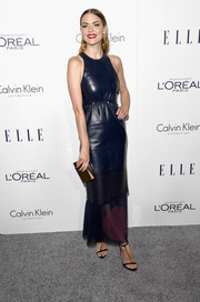 Jaime King styled her dress with a tricolor box clutch.