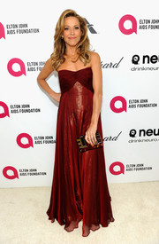 Sheryl Crow cut a flirty silhouette in a maroon strapless gown during the Elton John AIDS Foundation Oscar viewing party.