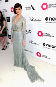 Paz Vega channeled Old Hollywood at Elton John's Oscar viewing party in a beaded blue Elie Saab Couture gown with a plunging neckline and a long train.