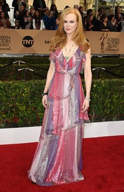 Nicole Kidman went all out with the colors for her SAG Awards look, wearing this shimmery multi-hued ruffle gown by Gucci.