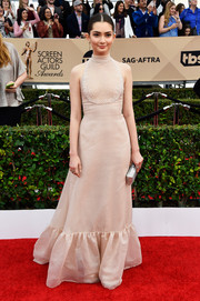 Emily Robinson looked exquisite at the SAG Awards in a nude Antonio Grimaldi halter gown with embroidered bib detail and a ruffle hem.