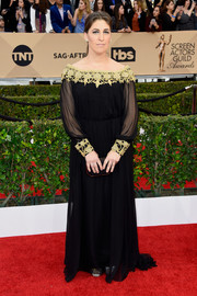 Mayim Bialik went for boho glamour in a black and gold off-the-shoulder gown by Oliver Tolentino at the SAG Awards.