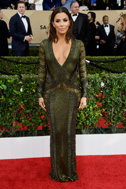 Eva Longoria amped up the allure with this beaded forest-green gown by Julien Macdonald, boasting a plunging neckline and intricate beading, at the SAG Awards.