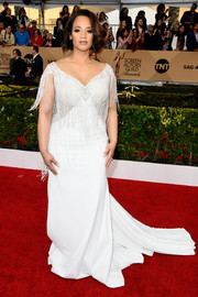 Dascha Polanco was flapper-glam at the SAG Awards in a white Nurit Hen fishtail gown with a fringed bodice.
