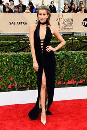 Renee Bargh was a scene stealer at the SAG Awards in a black Mugler halter dress with a strappy, down-to-the-navel neckline and a thigh-high slit.
