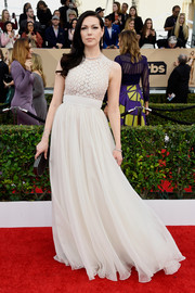 Laura Prepon channeled her inner princess in a white Carmen Marc Valvo Couture gown with a fitted, scale-like bodice and a full skirt.