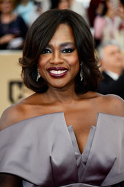 Viola Davis sported lavender eyeshadow to match her dress.