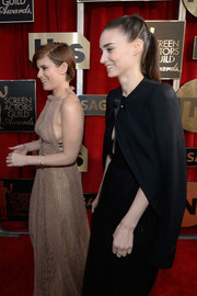 Rooney Mara arrived for the 2016 SAG Awards wearing a black tie-neck blazer over a matching dress.