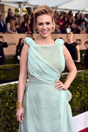 January Jones paired an Aurelie Bidermann layered gold bracelet with a pastel-blue gown for her SAG Awards look.