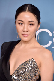 Constance Wu attended the 2020 Costume Designers Guild Awards wearing a simple center-parted ponytail.