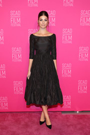 Camila Morrone channeled the '50s in a boat-neck, fit-and-flare LBD by Dior at the 2019 SCAD Savannah Film Festival.