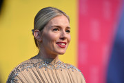 Sienna Miller opted for a casual chignon when she attended the 2019 SCAD Savannah Film Festival.