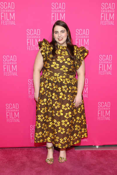 Beanie Feldstein coordinated her dress with a pair of crystal buckle-embellished leopard-print sandals.