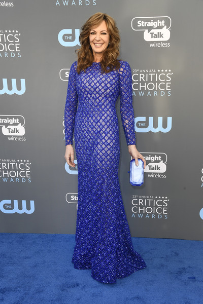 Allison Janney matched her dress with a pearlescent blue clutch.