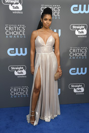 Susan Kelechi Watson struck a seductive pose in a high-slit pearlescent slip gown at the 2018 Critics' Choice Awards.