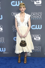 Haley Bennett opted for a Chloé midi dress with a deep-V neckline and a grommeted bodice when she attended the 2018 Critics' Choice Awards.