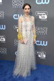 Zoe Kazan looked angelic at the 2018 Critics' Choice Awards in a floaty white and yellow Valentino gown that was adorned with a smattering of sequins.