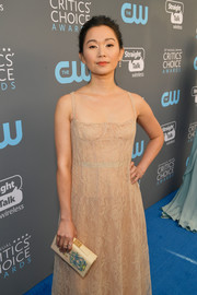Hong Chau paired an embroidered leather clutch with a lace gown, both by Dior, for the 2018 Critics' Choice Awards.
