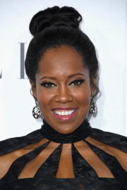 Regina King swept her hair up into a top knot for the Elle Women in Hollywood Awards.