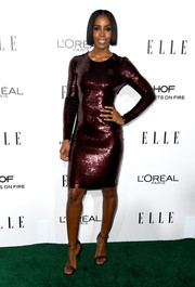 Kelly Rowland sheathed her toned physique in a purple sequin dress for the Elle Women in Hollywood Awards.