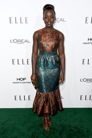 Lupita Nyong'o completed her metallic look with a pair of strappy gold sandals by Brian Atwood.